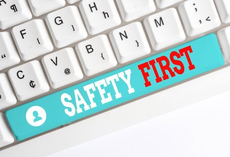 Word writing text Safety First. Business photo showcasing used to say that the most important thing is to be safe White pc keyboard with empty note paper above white background key copy space 스톡 콘텐츠