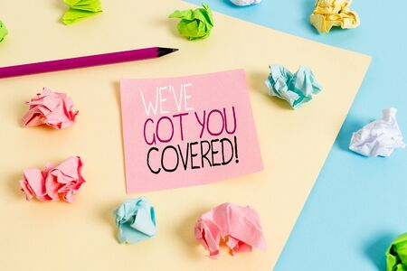 Writing note showing We Ve Got You Covered. Business concept for have done gotten or provided whatever needed Colored crumpled papers empty reminder blue yellow clothespin Stock Photo - 129851838