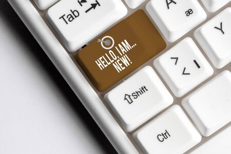 Text sign showing Hello I Am New. Business photo showcasing used greeting or begin telephone conversation White pc keyboard with empty note paper above white background key copy space