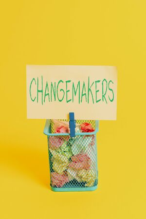 Handwriting text Changemakers. Conceptual photo Young Turk Influencers Acitivists Urbanization Fashion Gen X Trash bin crumpled paper clothespin empty reminder office supplies yellow