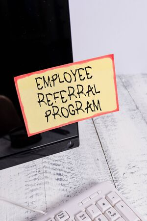 Word writing text Employee Referral Program. Business photo showcasing employees are rewarded for introducing recruits Notation paper taped to black computer monitor screen near white keyboard