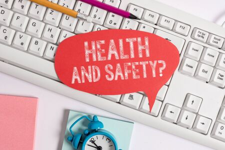 Handwriting text Health And Safety Question. Conceptual photo regulations and procedures to prevent accident or injury Empty copy space red note paper bubble above pc keyboard for text message 写真素材
