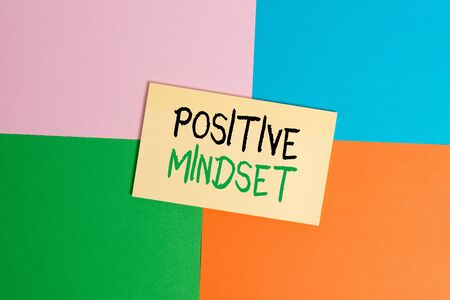 Text sign showing Positive Mindset. Business photo text mental attitude in wich you expect favorable results Office appliance colorful square desk study supplies empty paper sticker