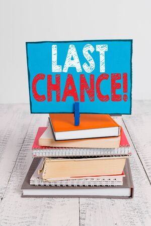 Writing note showing Last Chance. Business concept for final opportunity to achieve or acquire something you want pile stacked books notebook pin color reminder white wooden Imagens