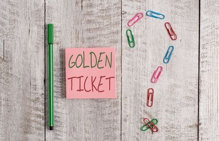 Word writing text Golden Ticket. Business photo showcasing Rain Check Access VIP Passport Box Office Seat Event Pastel colour note paper placed next to stationary above the wooden table Zdjęcie Seryjne