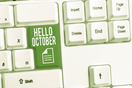 Conceptual hand writing showing Hello October. Concept meaning Last Quarter Tenth Month 30days Season Greeting White pc keyboard with note paper above the white background