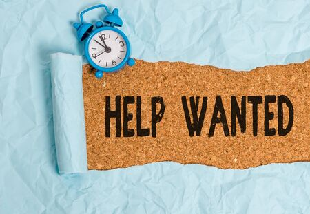 Handwriting text writing Help Wanted. Conceptual photo An ad in the paper an employer places to find a new employee