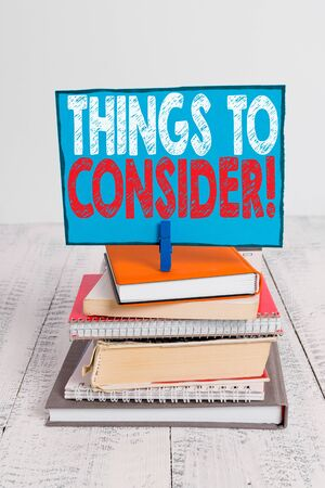 Writing note showing Things To Consider. Business concept for think about something carefully in order to make decision pile stacked books notebook pin color reminder white wooden