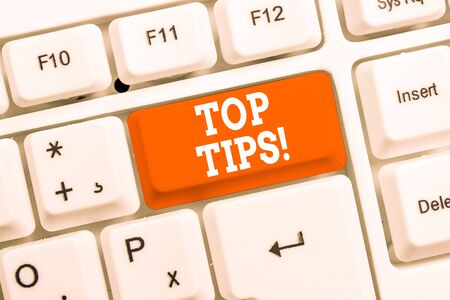 Handwriting text Top Tips. Conceptual photo small but particularly useful piece of practical advice White pc keyboard with empty note paper above white background key copy space