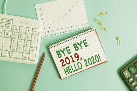 Conceptual hand writing showing Bye Bye 2019 Hello 2020. Concept meaning saying goodbye to last year and welcoming another good one Paper blue keyboard office study notebook chart numbers memo