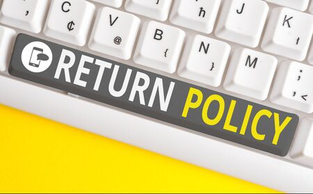 Conceptual hand writing showing Return Policy. Concept meaning Tax Reimbursement Retail Terms and Conditions on Purchase White pc keyboard with note paper above the white background