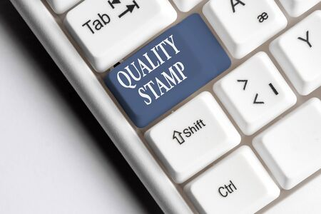 Text sign showing Quality Stamp. Business photo text Seal of Approval Good Impression Qualified Passed Inspection White pc keyboard with empty note paper above white background key copy space Stok Fotoğraf