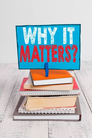 Writing note showing Why It Matters Question. Business concept for most important thing to be done when involved in situation pile stacked books notebook pin color reminder white wooden