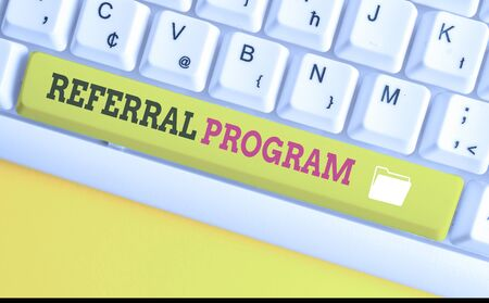 Text sign showing Referral Program. Business photo text employees are rewarded for introducing suitable recruits White pc keyboard with empty note paper above white background key copy space Stock Photo