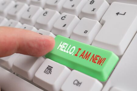 Word writing text Hello I Am New. Business photo showcasing introducing oneself in a group as fresh worker or student White pc keyboard with empty note paper above white background key copy space Zdjęcie Seryjne