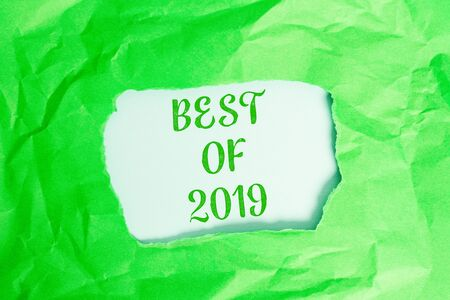 Text sign showing Best Of 2019. Business photo text great and marvelous things and events happened on 2019 Green crumpled ripped colored paper sheet centre torn colorful background