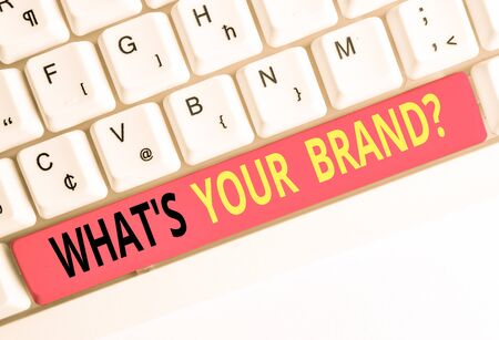 Handwriting text What S Your Brand Question. Conceptual photo asking about product does or what you communicate White pc keyboard with empty note paper above white background key copy space