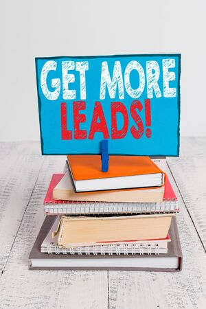 Writing note showing Get More Leads. Business concept for initiation consumer interest or enquiry products or services pile stacked books notebook pin color reminder white wooden Stock Photo