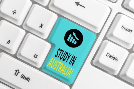 Word writing text Study In Australia. Business photo showcasing going into foreign country order complete your studies White pc keyboard with empty note paper above white background key copy space