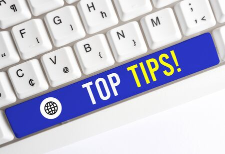 Writing note showing Top Tips. Business concept for small but particularly useful piece of practical advice White pc keyboard with note paper above the white background