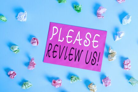 Writing note showing Please Review Us. Business concept for situation or system is formal examination by showing authority Colored crumpled rectangle shaped reminder paper light blue background Stock Photo