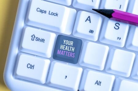 Writing note showing Your Health Matters. Business concept for good health is most important among other things White pc keyboard with note paper above the white background
