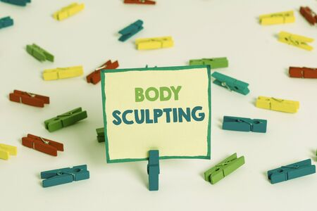 Conceptual hand writing showing Body Sculpting. Concept meaning activity of increasing the body s is visible muscle tone Colored clothespin papers empty reminder white floor office