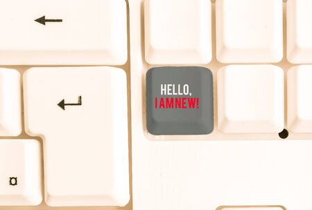 Writing note showing Hello I Am New. Business concept for introducing oneself in a group as fresh worker or student White pc keyboard with note paper above the white background Zdjęcie Seryjne