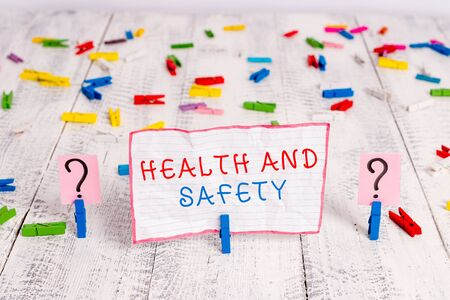 Handwriting text writing Health And Safety. Conceptual photo procedures intended to prevent accident in workplace Scribbled and crumbling sheet with paper clips placed on the wooden table