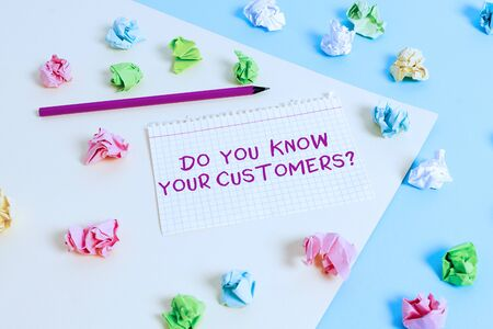 Text sign showing Do You Know Your Customers question. Business photo text asking to identify a customer s is nature Colored crumpled papers empty reminder blue yellow background clothespin