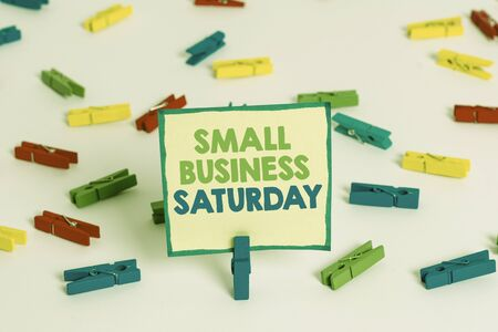 Conceptual hand writing showing Small Business Saturday. Concept meaning American shopping holiday held during the Saturday Colored clothespin papers empty reminder white floor office