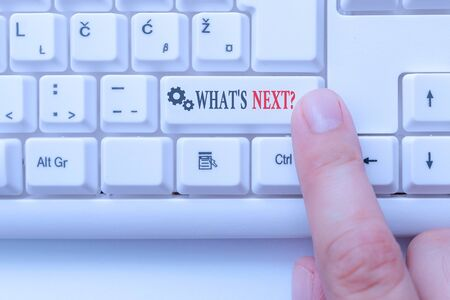 Conceptual hand writing showing What S Next Question. Concept meaning asking demonstrating about his coming action or behavior White pc keyboard with note paper above the white background Stock fotó