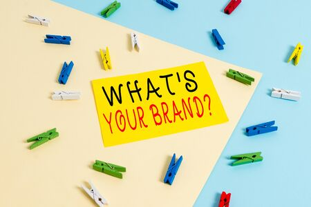 Text sign showing What S Your Brand Question. Business photo text asking about product logo does or what you communicate Colored clothespin paper empty reminder yellow blue floor background office