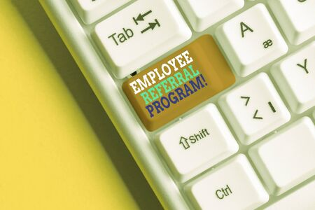 Writing note showing Employee Referral Program. Business concept for internal recruitment method employed by organizations White pc keyboard with note paper above the white background