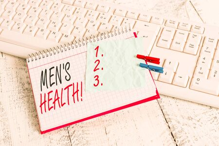Text sign showing Men S Health. Business photo showcasing state of complete physical mental and social well being by analysis notebook paper reminder clothespin pinned sheet white keyboard light wooden Banco de Imagens