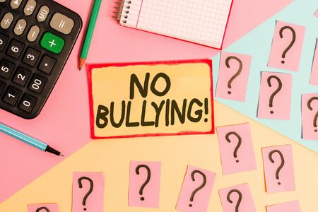 Text sign showing No Bullying. Business photo text stop aggressive behavior among children power imbalance Mathematics stuff and writing equipment above pastel colours background