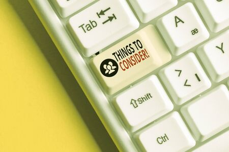 Word writing text Things To Consider. Business photo showcasing think about something carefully in order to make decision White pc keyboard with empty note paper above white background key copy space Stok Fotoğraf - 129850419