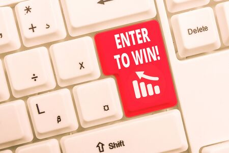 Text sign showing Enter To Win. Business photo text exchanging something value for prize chance winning prize White pc keyboard with empty note paper above white background key copy space