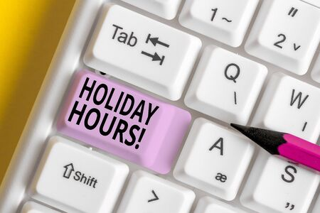 Conceptual hand writing showing Holiday Hours. Concept meaning Overtime work on for employees under flexible work schedules White pc keyboard with note paper above the white background