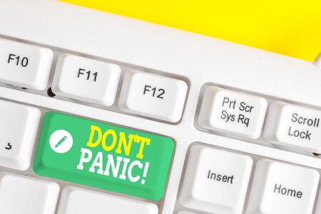 Text sign showing Don T Panic. Business photo showcasing suddenly feel so worried or frightened that you can not behave White pc keyboard with empty note paper above white background key copy space