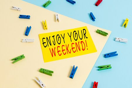 Text sign showing Enjoy Your Weekend. Business photo text wishing someone that something nice will happen at holiday Colored clothespin paper empty reminder yellow blue floor background office Archivio Fotografico