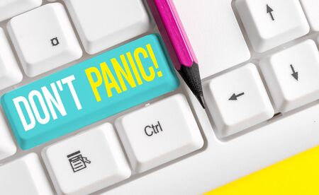 Handwriting text writing Don T Panic. Conceptual photo suddenly feel so worried or frightened that you can not behave White pc keyboard with empty note paper above white background key copy space 스톡 콘텐츠