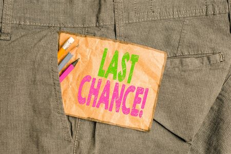 Handwriting text writing Last Chance. Conceptual photo final opportunity to achieve or acquire something you want Writing equipment and brown note paper inside pocket of man work trousers