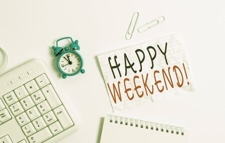 Writing note showing Happy Weekend. Business concept for something nice has happened or they feel satisfied with life Blank paper with copy space on the table with clock and pc keyboard