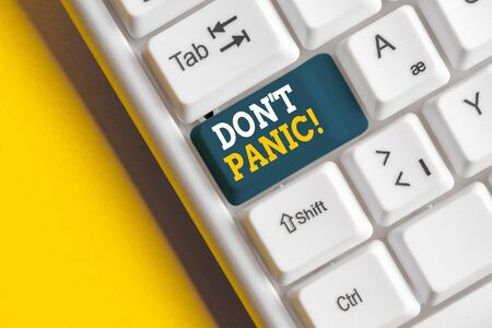 Conceptual hand writing showing Don T Panic. Concept meaning suddenly feel so worried or frightened that you can not behave White pc keyboard with note paper above the white background Stock fotó