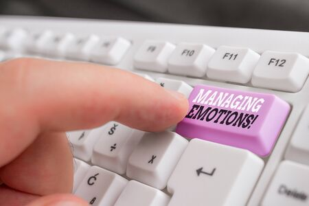 Text sign showing Managing Emotions. Business photo showcasing ability be open to feelings and modulate them in oneself White pc keyboard with empty note paper above white background key copy space Banque d'images