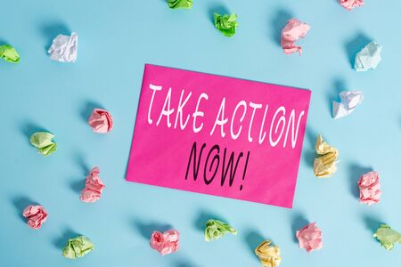 Writing note showing Take Action Now. Business concept for do something official or concerted achieve aim with problem Colored crumpled rectangle shaped reminder paper light blue background