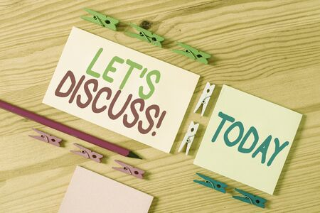 Handwriting text Let S Discuss. Conceptual photo asking someone to talk about something with demonstrating or showing Colored clothespin papers empty reminder wooden floor background office