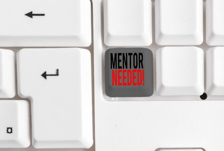 Text sign showing Mentor Needed. Business photo text Employee training under senior assigned act as advisor White pc keyboard with empty note paper above white background key copy space