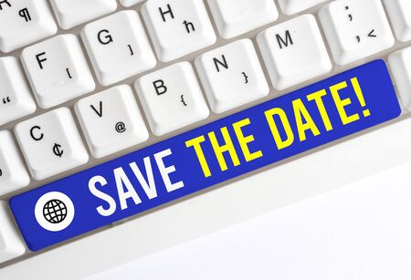 Writing note showing Save The Date. Business concept for remember not schedule anything else on this day White pc keyboard with note paper above the white background